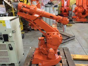 Photo of an orange piece of robotic equipment.